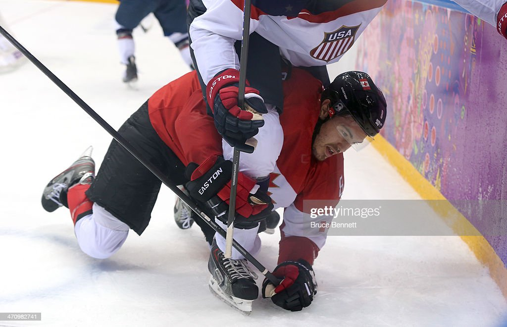 <a gi-track='captionPersonalityLinkClicked' href=/galleries/search?phrase=Drew+Doughty&family=editorial&specificpeople=2085761 ng-click='$event.stopPropagation()'>Drew Doughty</a> #8 of Canada falls to the ice going for the puck against the United States during the Men's Ice Hockey Semifinal Playoff on Day 14 of the 2014 Sochi Winter Olympics at Bolshoy Ice Dome on February 21, 2014 in Sochi, Russia.