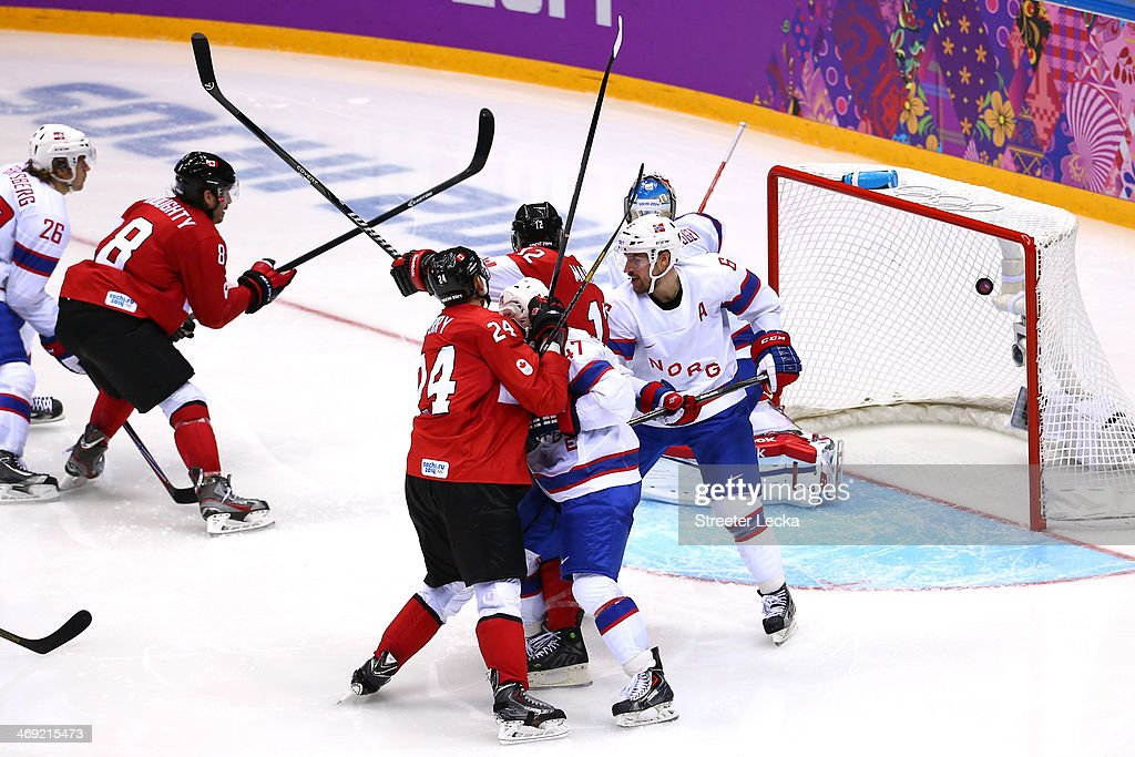<a gi-track='captionPersonalityLinkClicked' href=/galleries/search?phrase=Drew+Doughty&family=editorial&specificpeople=2085761 ng-click='$event.stopPropagation()'>Drew Doughty</a> #8 of Canada scores a goal in the third period against <a gi-track='captionPersonalityLinkClicked' href=/galleries/search?phrase=Lars+Haugen&family=editorial&specificpeople=7718894 ng-click='$event.stopPropagation()'>Lars Haugen</a> #30 of Norway during the Men's Ice Hockey Preliminary Round Group B game on day six of the Sochi 2014 Winter Olympics at Bolshoy Ice Dome on February 13, 2014 in Sochi, Russia.