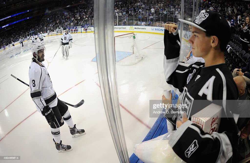 <a gi-track='captionPersonalityLinkClicked' href=/galleries/search?phrase=Drew+Doughty&family=editorial&specificpeople=2085761 ng-click='$event.stopPropagation()'>Drew Doughty</a> #8 of the Los Angeles Kings acknowledges an Los Angeles Kings fan in the third period of Game Four of the 2014 Stanley Cup Final at Madison Square Garden on June 11, 2014 in New York City. The Rangers won the game 2-1.