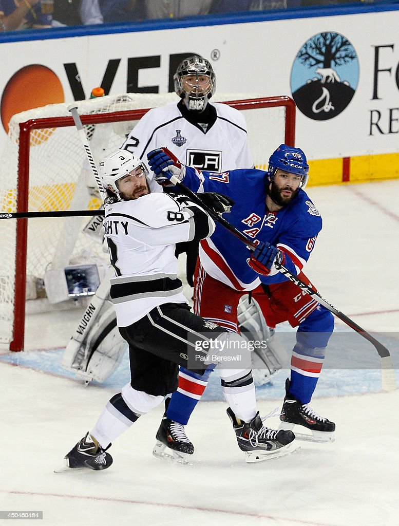 Drew Doughty #8 of the Los Angeles Kings and Benoit Pouliot #67 of the New York Rangers battle in front of Jonathan Quick #32 of the Los Angeles Kings during the second period of Game Four of the 2014 NHL Stanley Cup Final at Madison Square Garden on June 11, 2014 in New York, New York.