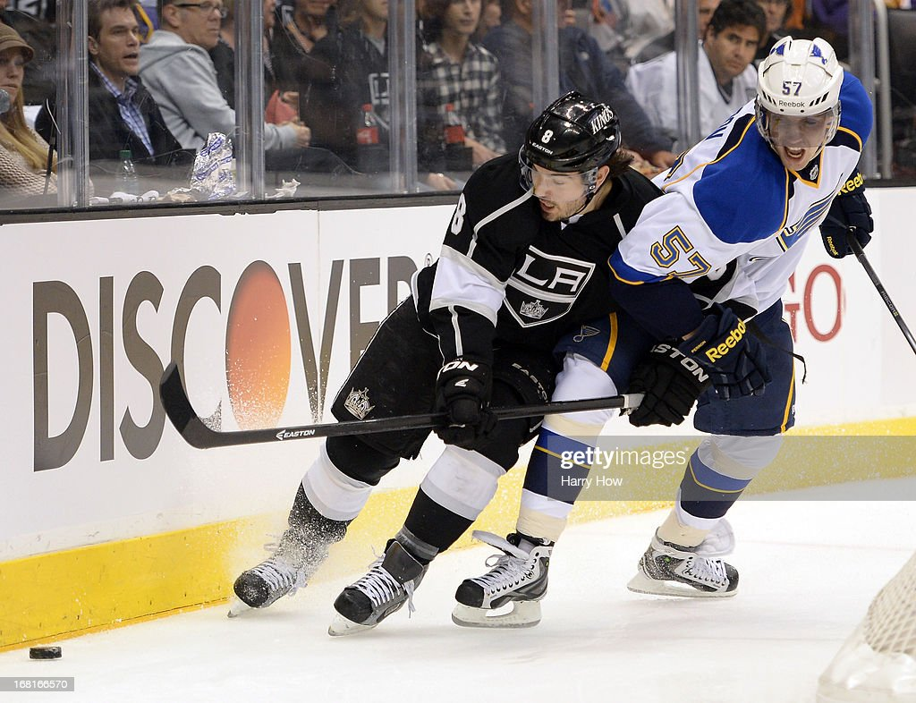 <a gi-track='captionPersonalityLinkClicked' href=/galleries/search?phrase=Drew+Doughty&family=editorial&specificpeople=2085761 ng-click='$event.stopPropagation()'>Drew Doughty</a> #8 of the Los Angeles Kings and <a gi-track='captionPersonalityLinkClicked' href=/galleries/search?phrase=David+Perron&family=editorial&specificpeople=4282591 ng-click='$event.stopPropagation()'>David Perron</a> #57 of the St. Louis Blues skate for the puck during a 1-0 Kings win in Game Three of the Western Conference Quarterfinals during the 2013 NHL Stanley Cup Playoffs at Staples Center on May 4, 2013 in Los Angeles, California.