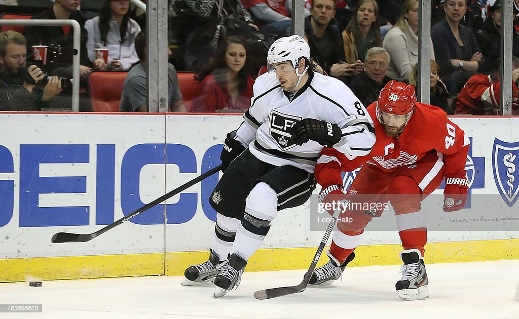 <a gi-track='captionPersonalityLinkClicked' href=/galleries/search?phrase=Drew+Doughty&family=editorial&specificpeople=2085761 ng-click='$event.stopPropagation()'>Drew Doughty</a> #8 of the Los Angeles Kings and <a gi-track='captionPersonalityLinkClicked' href=/galleries/search?phrase=Henrik+Zetterberg&family=editorial&specificpeople=201520 ng-click='$event.stopPropagation()'>Henrik Zetterberg</a> #40 of the Detroit Red Wings battle for puck control during the second period of the game at Joe Louis Arena on January 18, 2014 in Detroit, Michigan. The Wings defeated the Kings 3-2 in a shootout.
