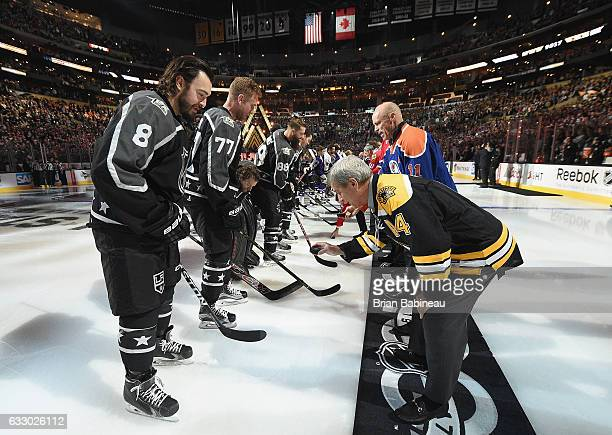 Drew Doughty of the Los Angeles Kings and Jeff Carter of the Los Angeles Kings wait for former players Bobby Orr and Mark Messier respectively to...