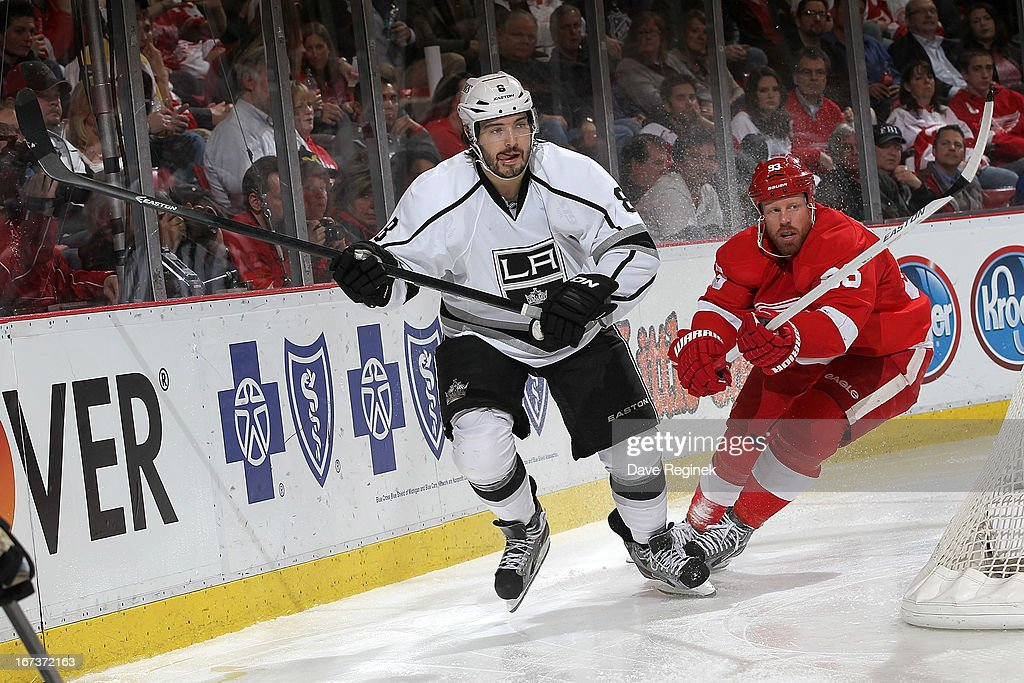 Drew Doughty #8 of the Los Angeles Kings and Johan Franzen #93 of the Detroit Red Wings circle around the net during a NHL game at Joe Louis Arena on April 24, 2013 in Detroit, Michigan. Detroit defeated Los Angeles 3-1