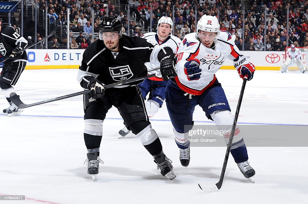 <a gi-track='captionPersonalityLinkClicked' href=/galleries/search?phrase=Drew+Doughty&family=editorial&specificpeople=2085761 ng-click='$event.stopPropagation()'>Drew Doughty</a> #8 of the Los Angeles Kings battles for position against <a gi-track='captionPersonalityLinkClicked' href=/galleries/search?phrase=Troy+Brouwer&family=editorial&specificpeople=4155305 ng-click='$event.stopPropagation()'>Troy Brouwer</a> #20 of the Washington Capitals at Staples Center on March 20, 2014 in Los Angeles, California.