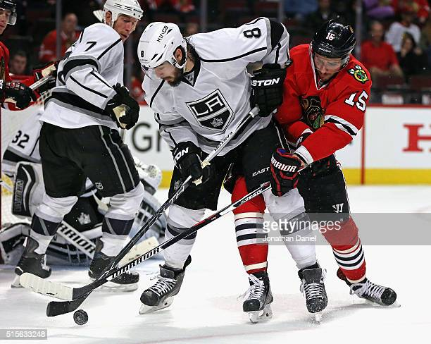 Drew Doughty of the Los Angeles Kings battles for the puck with Artem Anisimov of the Chicago Blackhawks at the United Center on March 14 2016 in...