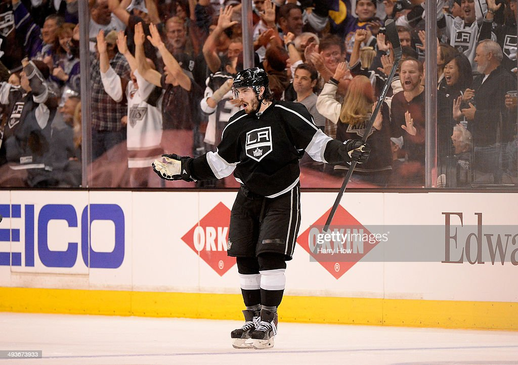 <a gi-track='captionPersonalityLinkClicked' href=/galleries/search?phrase=Drew+Doughty&family=editorial&specificpeople=2085761 ng-click='$event.stopPropagation()'>Drew Doughty</a> #8 of the Los Angeles Kings celebrates after he scores a third period goal against the Chicago Blackhawks in Game Three of the Western Conference Final during the 2014 Stanley Cup Playoffs at Staples Center on May 24, 2014 in Los Angeles, California.