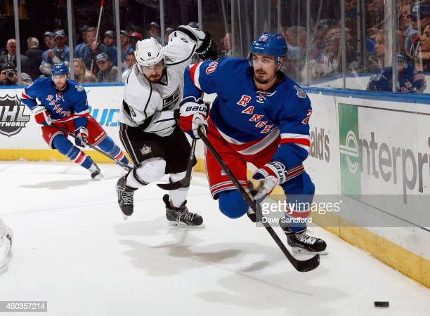 Drew Doughty of the Los Angeles Kings chases Chris Kreider of the New York Rangers during Game Three of the 2014 Stanley Cup Final at Madison Square...