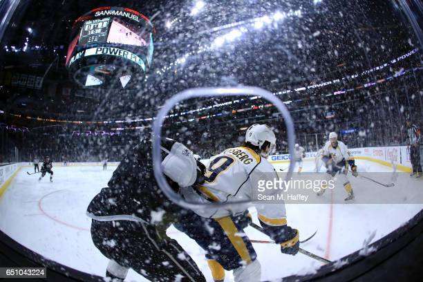 Drew Doughty of the Los Angeles Kings chases Filip Forsberg of the Nashville Predators during the second period of a game at Staples Center on March...