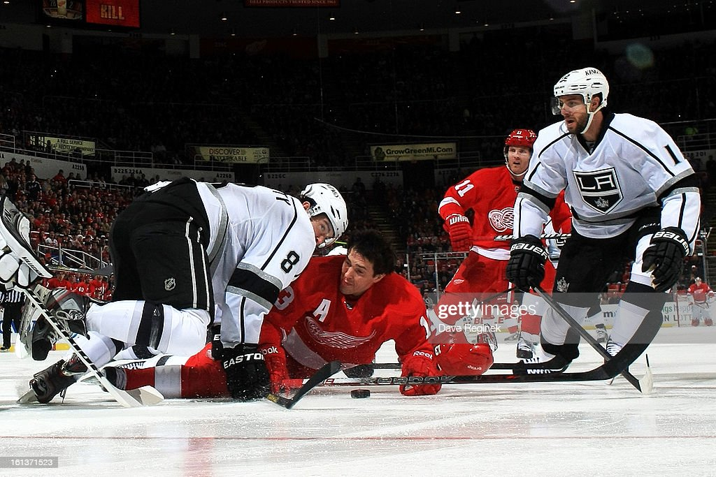 <a gi-track='captionPersonalityLinkClicked' href=/galleries/search?phrase=Drew+Doughty&family=editorial&specificpeople=2085761 ng-click='$event.stopPropagation()'>Drew Doughty</a> #8 of the Los Angeles Kings checks <a gi-track='captionPersonalityLinkClicked' href=/galleries/search?phrase=Pavel+Datsyuk&family=editorial&specificpeople=202893 ng-click='$event.stopPropagation()'>Pavel Datsyuk</a> #13 of the Detroit Red Wings during a NHL game at Joe Louis Arena on February 10, 2013 in Detroit, Michigan.