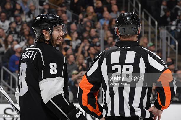 Drew Doughty of the Los Angeles Kings converses with referee Chris Lee during a game against the Boston Bruins at STAPLES Center on March 19 2016 in...