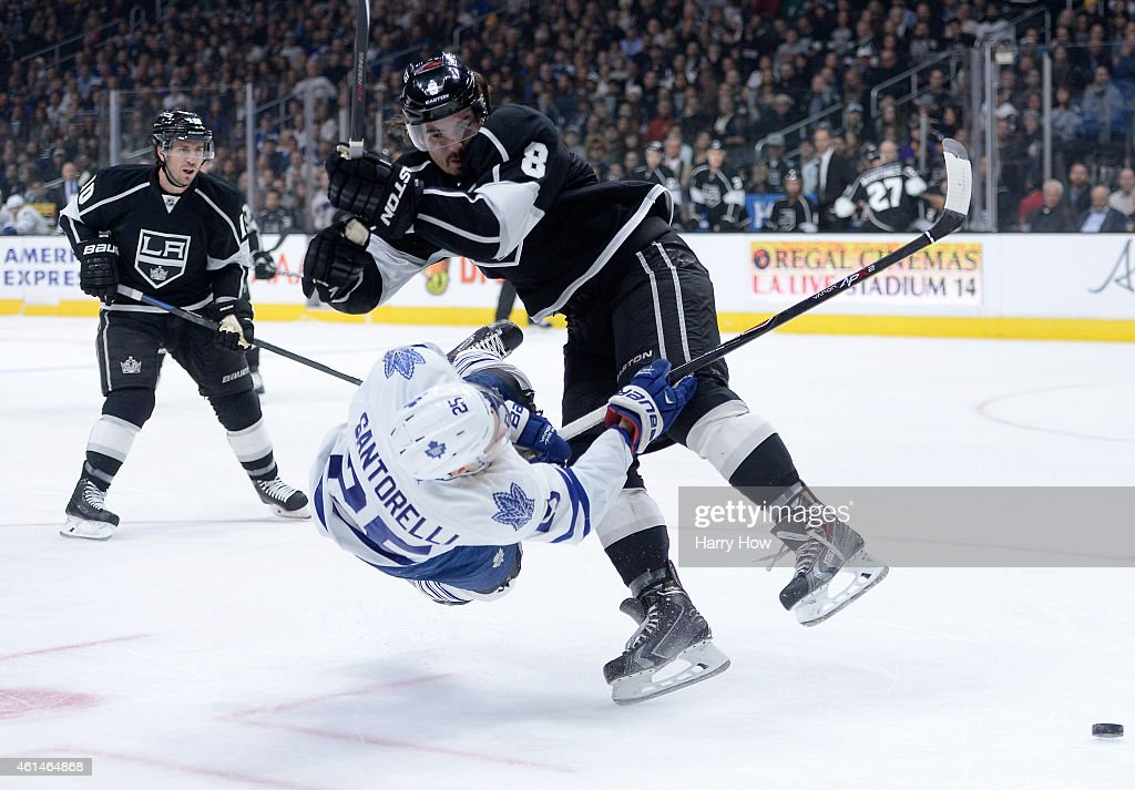 <a gi-track='captionPersonalityLinkClicked' href=/galleries/search?phrase=Drew+Doughty&family=editorial&specificpeople=2085761 ng-click='$event.stopPropagation()'>Drew Doughty</a> #8 of the Los Angeles Kings hits <a gi-track='captionPersonalityLinkClicked' href=/galleries/search?phrase=Mike+Santorelli&family=editorial&specificpeople=4517042 ng-click='$event.stopPropagation()'>Mike Santorelli</a> #25 of the Toronto Maple Leafs as he shoots in front of <a gi-track='captionPersonalityLinkClicked' href=/galleries/search?phrase=Mike+Richards+-+Ice+Hockey+Player&family=editorial&specificpeople=221189 ng-click='$event.stopPropagation()'>Mike Richards</a> #10 during the first period at Staples Center on January 12, 2015 in Los Angeles, California.