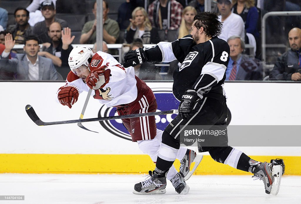 Drew Doughty of the Los Angeles Kings knocks over Shane Doan of the Phoenix Coyotes in the third period in Game Three of the Western Conference Final...