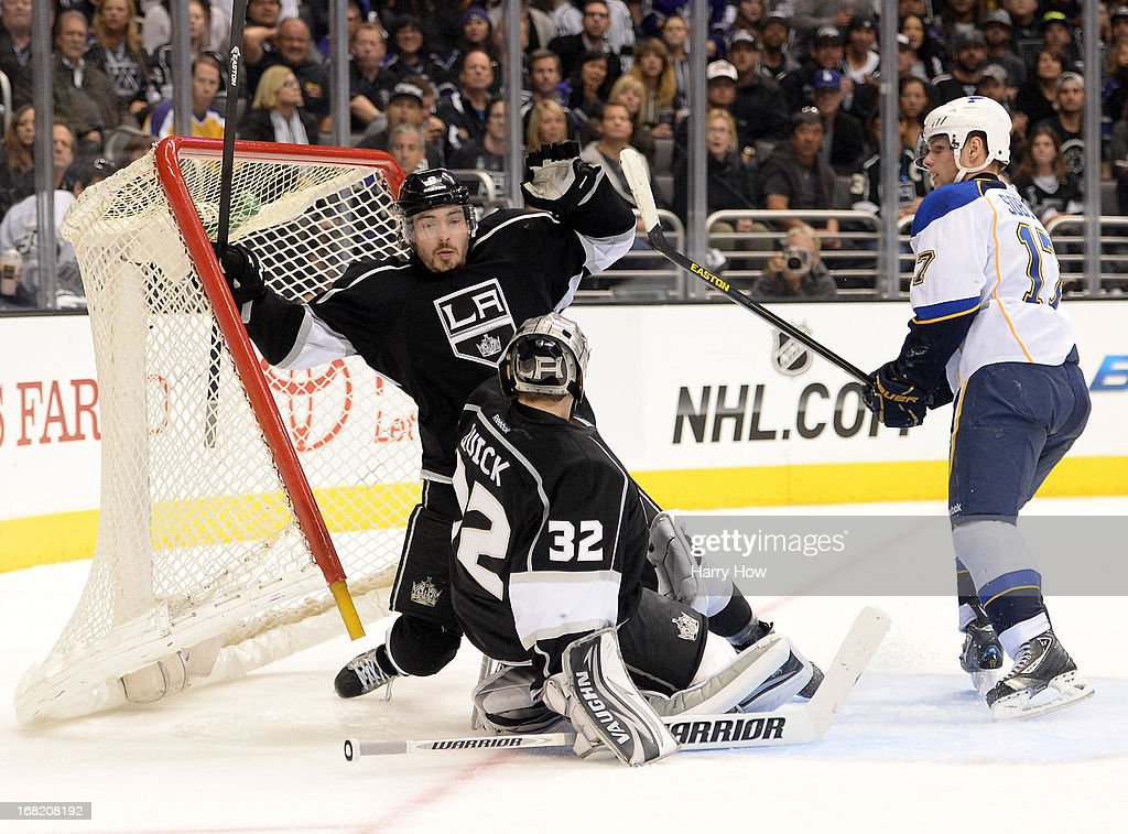 <a gi-track='captionPersonalityLinkClicked' href=/galleries/search?phrase=Drew+Doughty&family=editorial&specificpeople=2085761 ng-click='$event.stopPropagation()'>Drew Doughty</a> #8 of the Los Angeles Kings knocks the net off after a push from <a gi-track='captionPersonalityLinkClicked' href=/galleries/search?phrase=Vladimir+Sobotka&family=editorial&specificpeople=716736 ng-click='$event.stopPropagation()'>Vladimir Sobotka</a> #17 of the St. Louis Blues as <a gi-track='captionPersonalityLinkClicked' href=/galleries/search?phrase=Jonathan+Quick&family=editorial&specificpeople=2271852 ng-click='$event.stopPropagation()'>Jonathan Quick</a> #32 looks on during the third period in Game Four of the Western Conference Quarterfinals during the 2013 NHL Stanley Cup Playoffs at Staples Center on May 6, 2013 in Los Angeles, California. The Kings won 4-3.