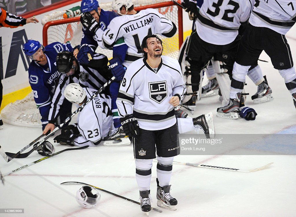 <a gi-track='captionPersonalityLinkClicked' href=/galleries/search?phrase=Drew+Doughty&family=editorial&specificpeople=2085761 ng-click='$event.stopPropagation()'>Drew Doughty</a> #8 of the Los Angeles Kings laughs as he watches the brawl behind him on the jumbotron during the game against the Vancouver Canucks in Game Two of the Western Conference Quarterfinals during the 2012 NHL Stanley Cup Playoffs at Rogers Arena on April, 13, 2012 in Vancouver, British Columbia, Canada.
