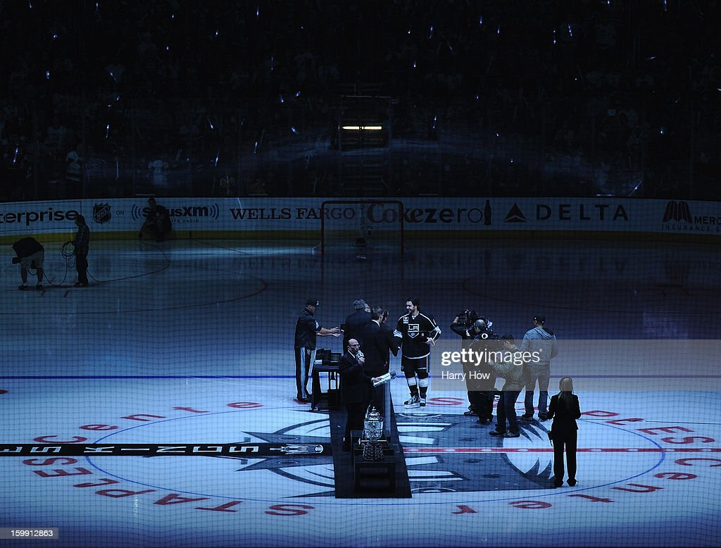 Drew Doughty #8 of the Los Angeles Kings receives his Stanley Cup ring during a ceremony to begin the season before the game against the Chicago Blackhawks at Staples Center on January 19, 2013 in Los Angeles, California.