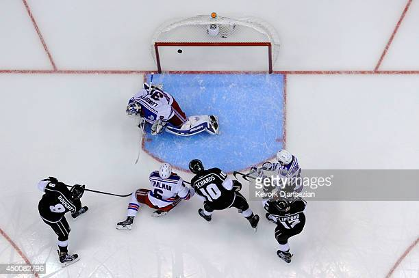 Drew Doughty of the Los Angeles Kings scores a second period goal past Henrik Lundqvist of the New York Rangers during Game One of the 2014 NHL...