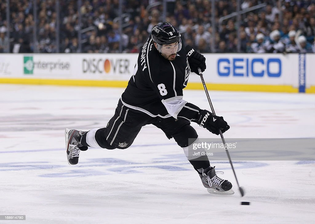 <a gi-track='captionPersonalityLinkClicked' href=/galleries/search?phrase=Drew+Doughty&family=editorial&specificpeople=2085761 ng-click='$event.stopPropagation()'>Drew Doughty</a> #8 of the Los Angeles Kings shoots and scores a goal against the San Jose Sharks in the second period of Game Two of the Western Conference Semifinals during the 2013 NHL Stanley Cup Playoffs at Staples Center on May 16, 2013 in Los Angeles, California. The Kings defeated the Sharks 4-3.