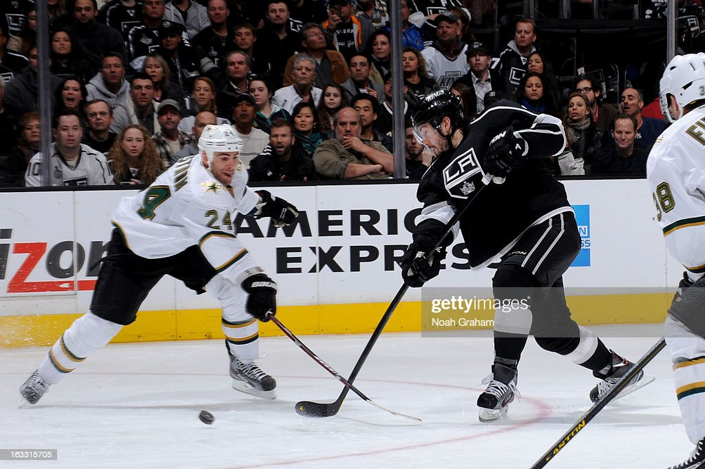 <a gi-track='captionPersonalityLinkClicked' href=/galleries/search?phrase=Drew+Doughty&family=editorial&specificpeople=2085761 ng-click='$event.stopPropagation()'>Drew Doughty</a> #8 of the Los Angeles Kings shoots the puck against <a gi-track='captionPersonalityLinkClicked' href=/galleries/search?phrase=Eric+Nystrom&family=editorial&specificpeople=2209813 ng-click='$event.stopPropagation()'>Eric Nystrom</a> #24 of the Dallas Stars at Staples Center on March 7, 2013 in Los Angeles, California.