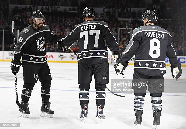 Drew Doughty of the Los Angeles Kings skates over to congratulate teammate Jeff Carter of the Los Angeles Kings during the Central Division and...