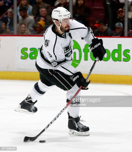 Drew Doughty of the Los Angeles Kings skates up ice with the puck during their NHL game against the Vancouver Canucks at Rogers Arena March 31 2017...