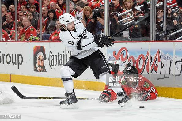 Drew Doughty of the Los Angeles Kings swings at the puck as Brandon Saad of the Chicago Blackhawks lays on the ice in Game Five of the Western...