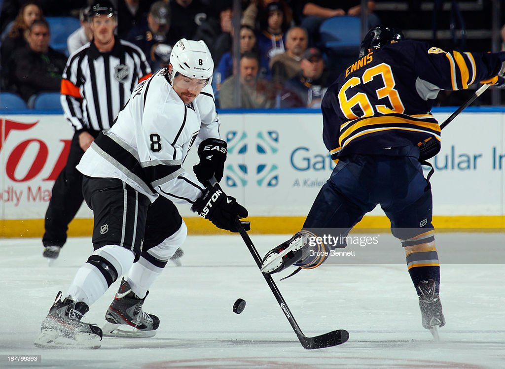 Drew Doughty #8 of the Los Angeles Kings takes the puck from Tyler Ennis #63 of the Buffalo Sabres at the First Niagara Center on November 12, 2013 in Buffalo, New York.