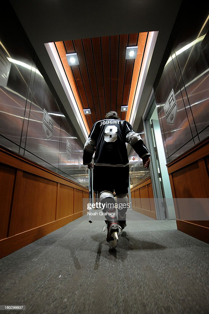 Drew Doughty #8 of the Los Angeles Kings walks back to the locker room after warming up prior to the game against the Vancouver Canucks at Staples Center on January 28, 2013 in Los Angeles, California.