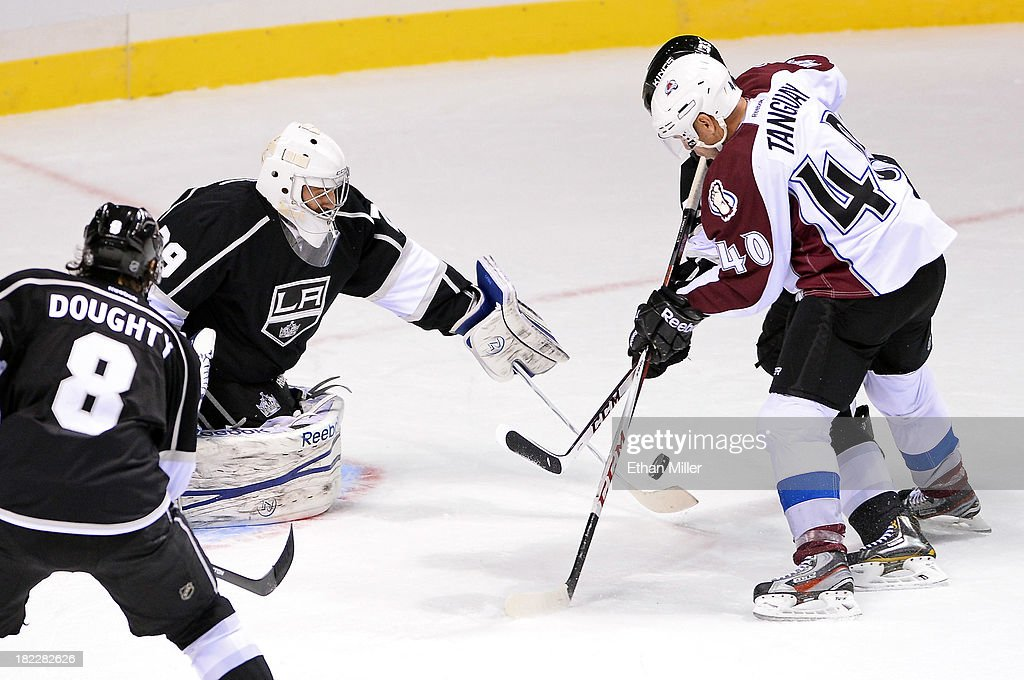 Drew Doughty #8 of the Los Angeles Kings watches as goalie <a gi-track='captionPersonalityLinkClicked' href=/galleries/search?phrase=Mathieu+Garon&family=editorial&specificpeople=206119 ng-click='$event.stopPropagation()'>Mathieu Garon</a> #29 deflects a shot by <a gi-track='captionPersonalityLinkClicked' href=/galleries/search?phrase=Alex+Tanguay&family=editorial&specificpeople=203231 ng-click='$event.stopPropagation()'>Alex Tanguay</a> #40 of the Colorado Avalanche during their preseason game at the MGM Grand Garden Arena on September 28, 2013 in Las Vegas, Nevada. Colorado won 3-2.