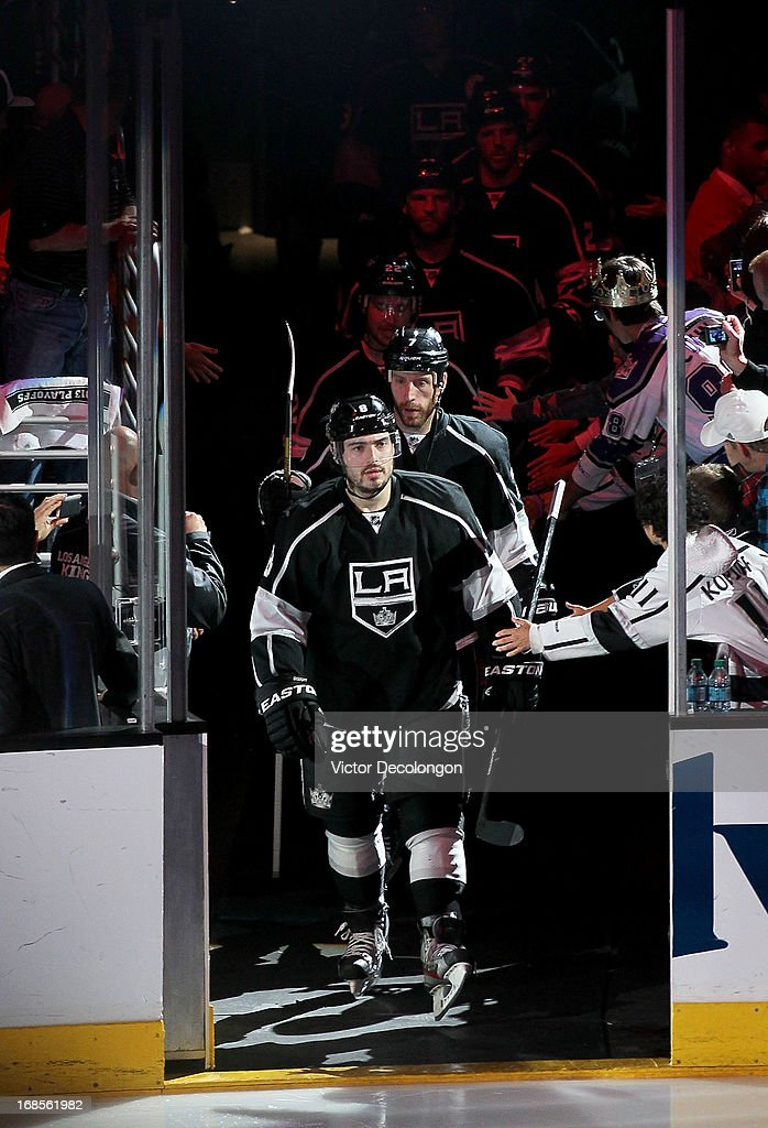 Drew Doughty #8, Rob Scuderi #7 and the rest of the Los Angeles Kings take the ice for the first period of Game Six of the Western Conference Quarterfinals against the St. Louis Blues during the 2013 NHL Stanley Cup Playoffs at Staples Center on May 10, 2013 in Los Angeles, California. The Kings defeated the Blues 2-1 to win the series 4 games to 2 and advance to the Western Conference Semifinals.