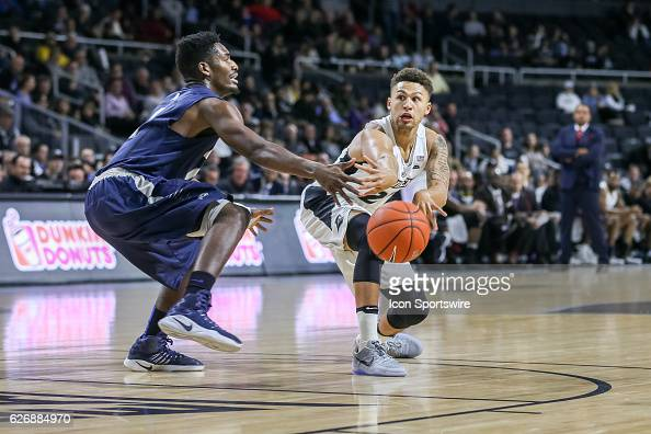 Drew Edwards Guard for Providence College passes the ball in the lane during the game between the Providence College Friars and the University of New...