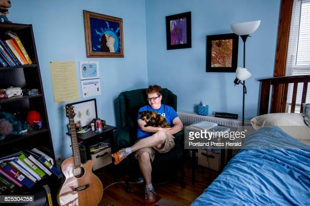Drew Floyd of Portland sits in a chair in her bedroom where she meditates and spends time with her animals like cat Lucy as she deals with chronic...