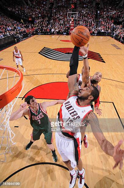 Drew Gooden of the Milwaukee Bucks and LaMarcus Aldridge of the Portland Trail Blazers reach for the ball during the game on March 20 2012 at the...