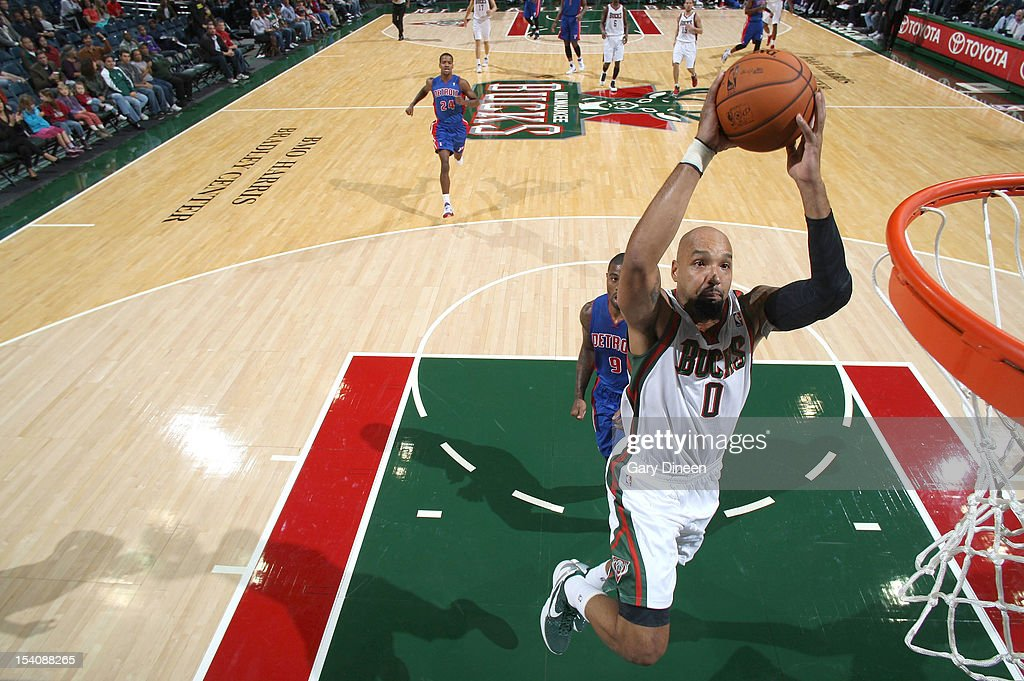 <a gi-track='captionPersonalityLinkClicked' href=/galleries/search?phrase=Drew+Gooden&family=editorial&specificpeople=201750 ng-click='$event.stopPropagation()'>Drew Gooden</a> #0 of the Milwaukee Bucks dunks against <a gi-track='captionPersonalityLinkClicked' href=/galleries/search?phrase=Terrence+Williams&family=editorial&specificpeople=666450 ng-click='$event.stopPropagation()'>Terrence Williams</a> #9 of the Detroit Pistons during the NBA preseason game on October 13, 2012 at the BMO Harris Bradley Center in Milwaukee, Wisconsin.