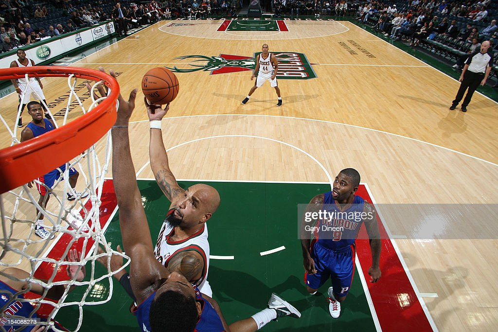 <a gi-track='captionPersonalityLinkClicked' href=/galleries/search?phrase=Drew+Gooden&family=editorial&specificpeople=201750 ng-click='$event.stopPropagation()'>Drew Gooden</a> #0 of the Milwaukee Bucks shoots against <a gi-track='captionPersonalityLinkClicked' href=/galleries/search?phrase=Andre+Drummond&family=editorial&specificpeople=7122456 ng-click='$event.stopPropagation()'>Andre Drummond</a> #1 of the Detroit Pistons during the NBA preseason game on October 13, 2012 at the BMO Harris Bradley Center in Milwaukee, Wisconsin.