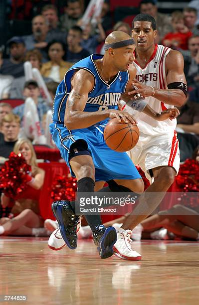 Drew Gooden of the Orlando Magic looks to spin on Jim Jackson of the Houston Rockets at the Toyota Center on November 8 2003 in Houston Texas The...