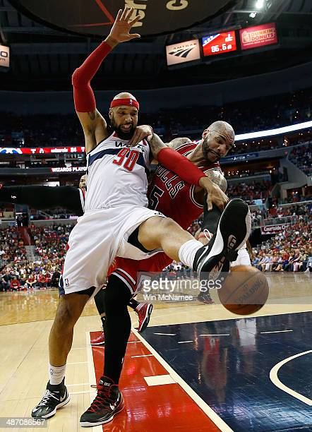 Drew Gooden of the Washington Wizards and Carlos Boozer of the Chicago Bulls fight for a rebound in Game Four of the Eastern Conference Quarterfinals...