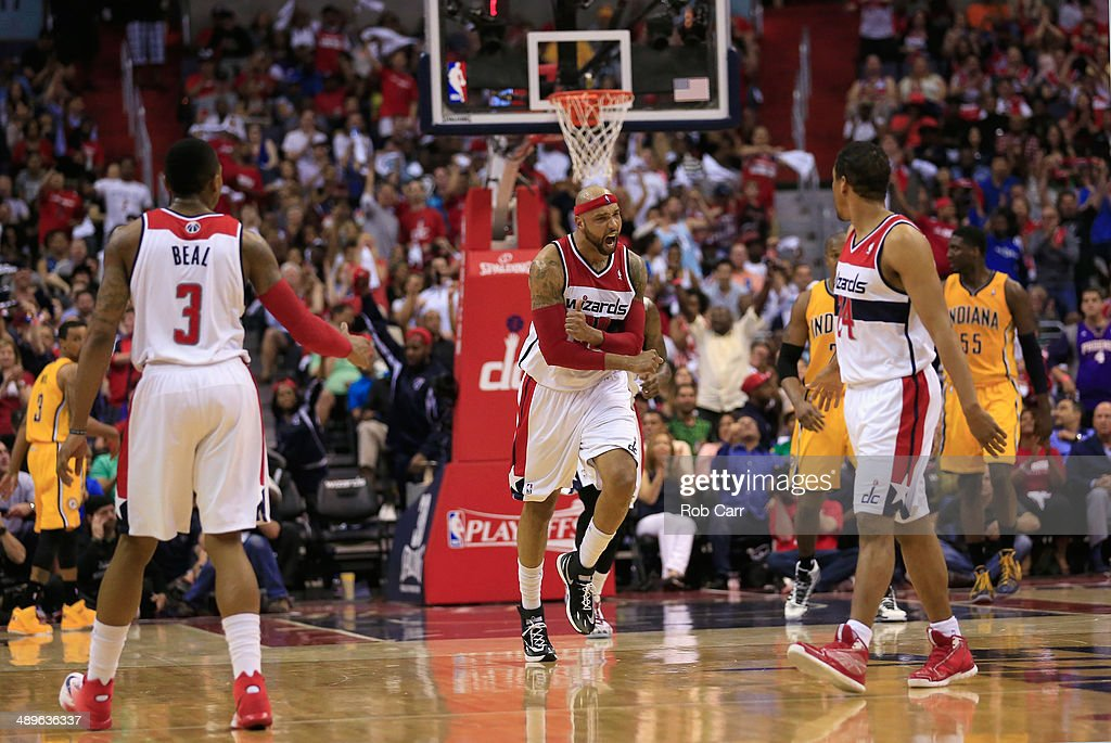 <a gi-track='captionPersonalityLinkClicked' href=/galleries/search?phrase=Drew+Gooden&family=editorial&specificpeople=201750 ng-click='$event.stopPropagation()'>Drew Gooden</a> #90 of the Washington Wizards celebrates after scoring against the Indiana Pacers during the first half of Game Four of the Eastern Conference Semifinals during the 2014 NBA Playoffs at Verizon Center on May 11, 2014 in Washington, DC.