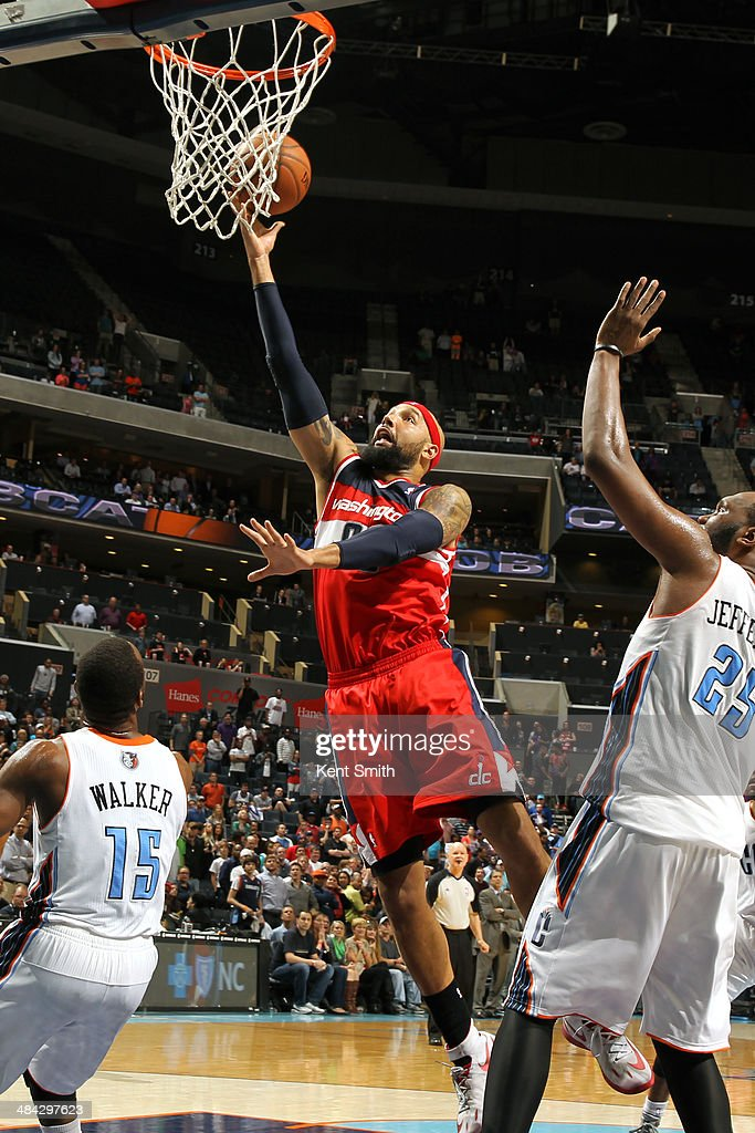 <a gi-track='captionPersonalityLinkClicked' href=/galleries/search?phrase=Drew+Gooden&family=editorial&specificpeople=201750 ng-click='$event.stopPropagation()'>Drew Gooden</a> #90 of the Washington Wizards goes up for a shot against the Charlotte Bobcats during the game at the Time Warner Cable Arena on March 31, 2014 in Charlotte, North Carolina.