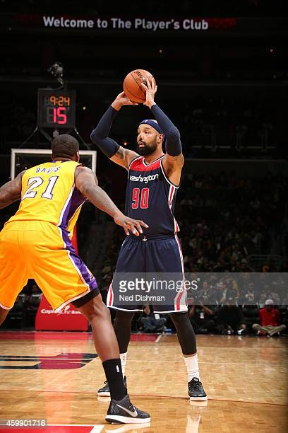 Drew Gooden of the Washington Wizards looks to pass against Ed Davis of the Los Angeles Lakers on December 3 2014 at the Verizon Center in Washington...
