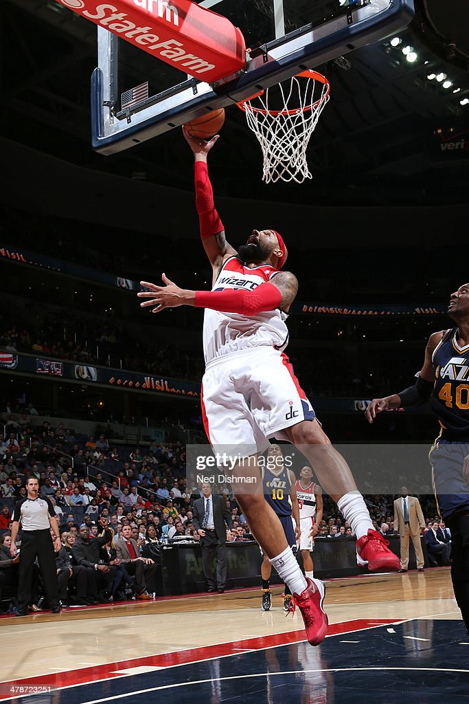 <a gi-track='captionPersonalityLinkClicked' href=/galleries/search?phrase=Drew+Gooden&family=editorial&specificpeople=201750 ng-click='$event.stopPropagation()'>Drew Gooden</a> #90 of the Washington Wizards shoots against the Utah Jazz at the Verizon Center on March 5, 2014 in Washington, DC.