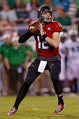 Drew Hare of the Northern Illinois Huskies drops back to throw during the first half of the game against the Northern Illinois Huskies at FAU Stadium...