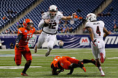 Drew Hare of the Northern Illinois Huskies leaps for a first down during the first quarter of the MAC Championship game against the Bowling Green...