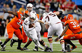 Drew Hare of the Northern Illinois Huskies runs for a short gain during the MAC Championship game against the Bowling Green Falcons at Ford Field on...