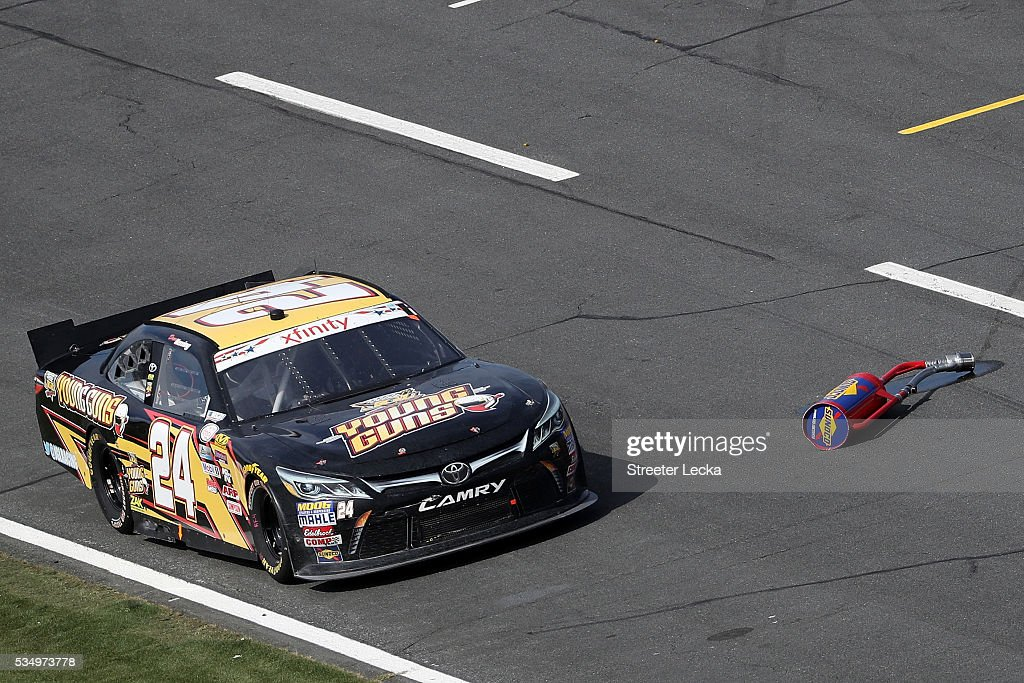 Drew Herring, driver of the #24 JGL Young Guns Toyota, drives down pit road past a gas can from the pit stall of Brennan Poole, driver of the #48 DC Solar Chevrolet, during the NASCAR XFINITY Series Hisense 300 at Charlotte Motor Speedway on May 28, 2016 in Charlotte, North Carolina.
