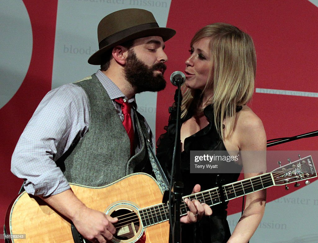 Drew Holcomb and Ellie Holcomb of Drew Holcomb and the Neighbors perform during the Red Tie Gala Hosted by Blood:Water Mission and sponsored by Noodle & Boo at Hutton Hotel on November 21, 2013 in Nashville, Tennessee.