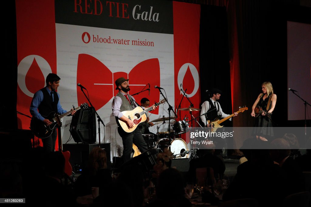 Drew Holcomb and the Neighbors perform during the Red Tie Gala Hosted by Blood:Water Mission and sponsored by Noodle & Boo at Hutton Hotel on November 21, 2013 in Nashville, Tennessee.
