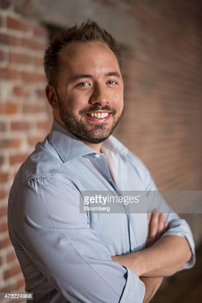 Drew Houston chief executive officer and cofounder of Dropbox Inc poses for a photograph following a Bloomberg Studio 10 television interview in San...