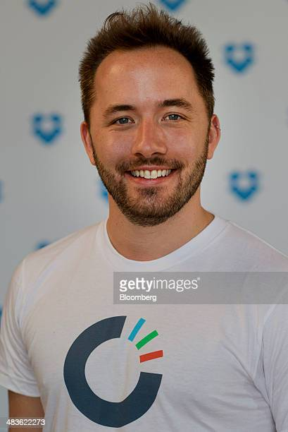 Drew Houston chief executive officer and cofounder of Dropbox Inc stands for a photograph after a Bloomberg West interview in San Francisco...