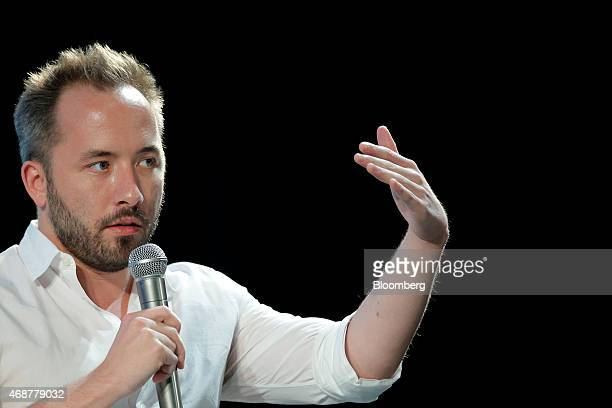 Drew Houston chief executive officer and cofounder of Dropbox Inc gestures as he delivers a keynote speech at the New Economy Summit 2015 in Tokyo...